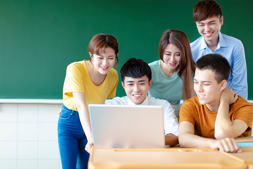 istock Class Of University Students Using Laptops In classroom 1145624873