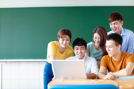 istock Class Of University Students Using Laptops In classroom 1145624880