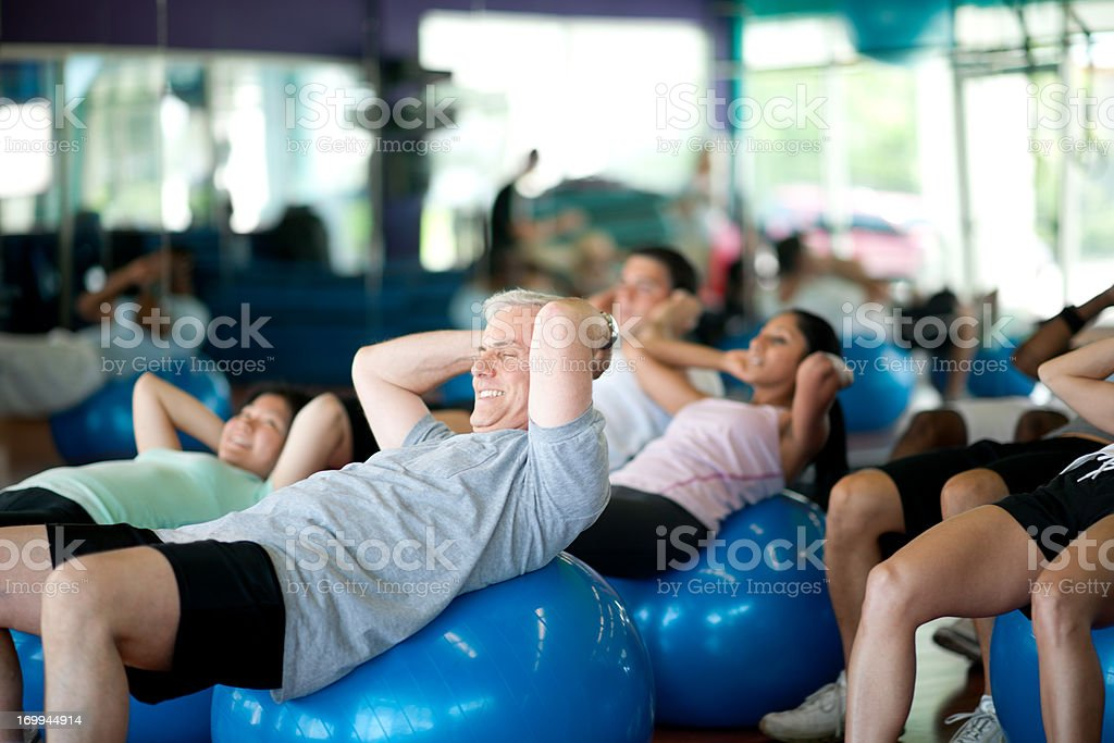 Class on exercise balls working out in gym royalty-free stock photo
