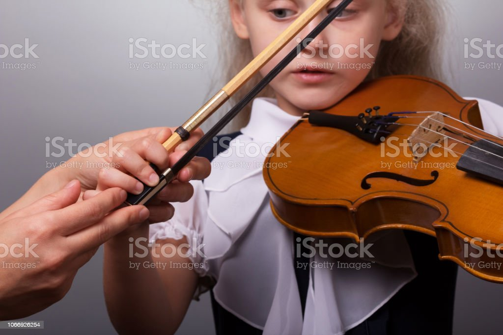 Class Study Of Playing The Violin The Little Girl Teacher Is