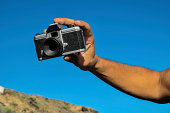 Vintage old 35mm cameras, lenses and light meter on white background