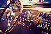 old fashioned image of a classic American car interior
