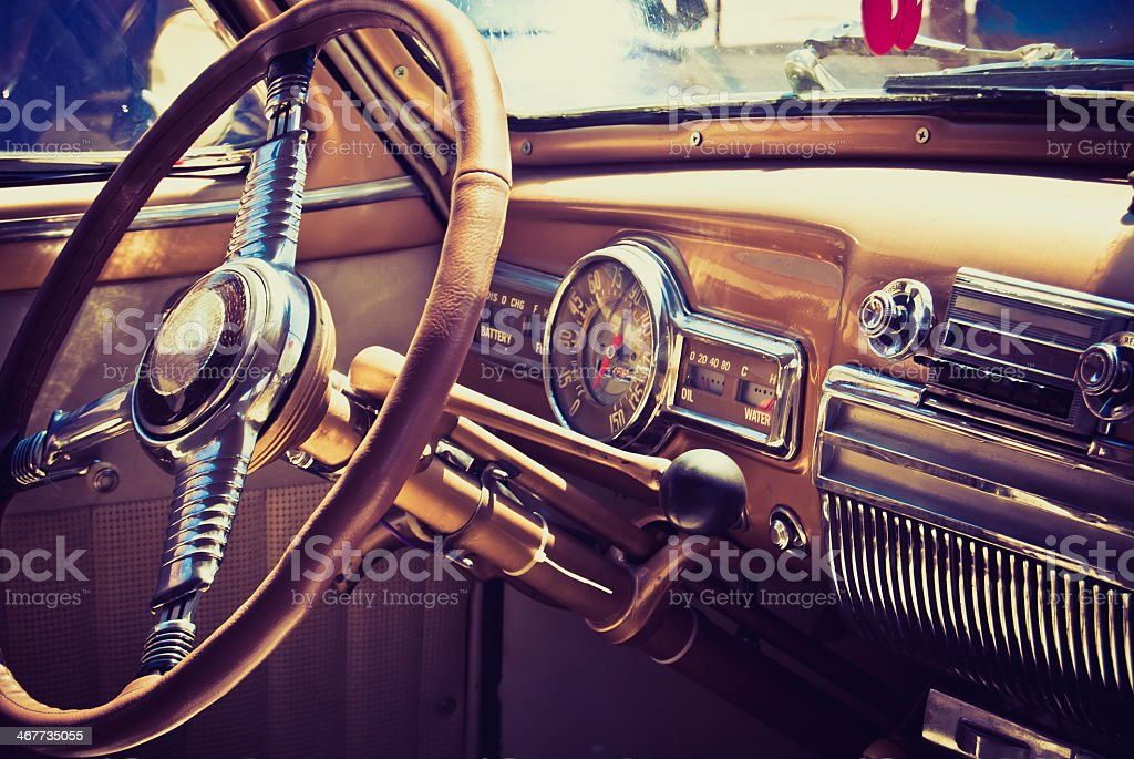 A classic American 60's inside of a car stock photo