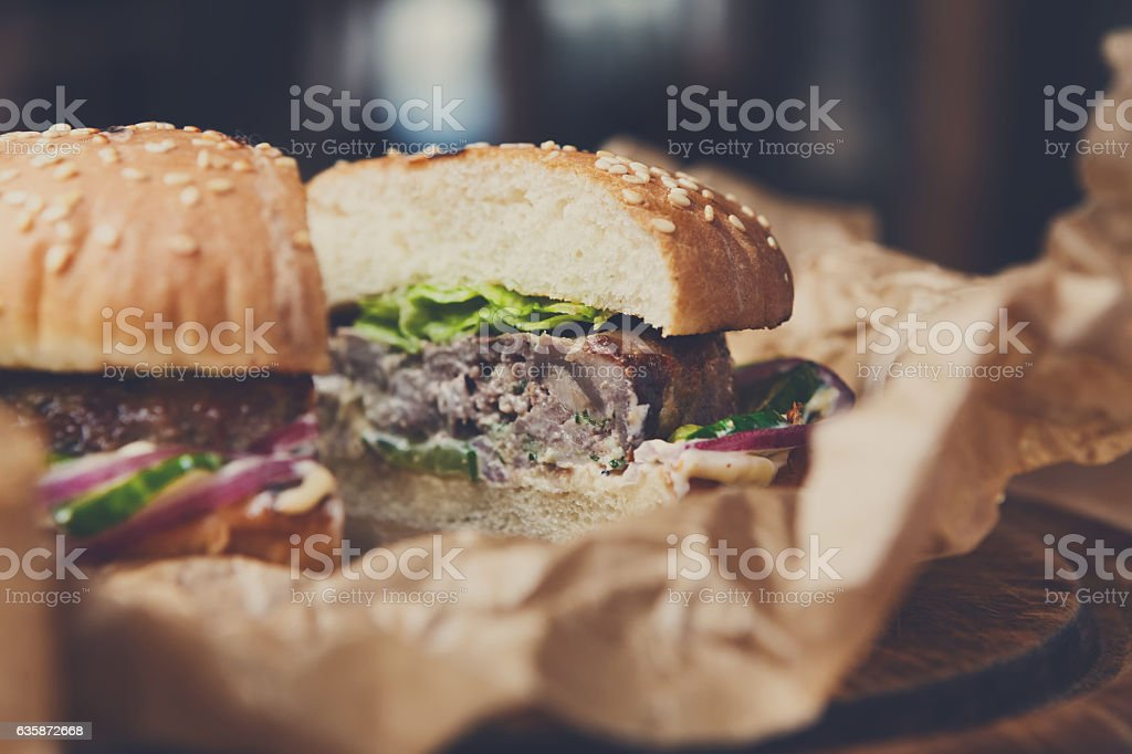 Classic american burgers, fast food on wood background stock photo
