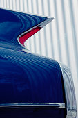 Classic American Car Tail Fin Against Corrugated Iron Metal Wall