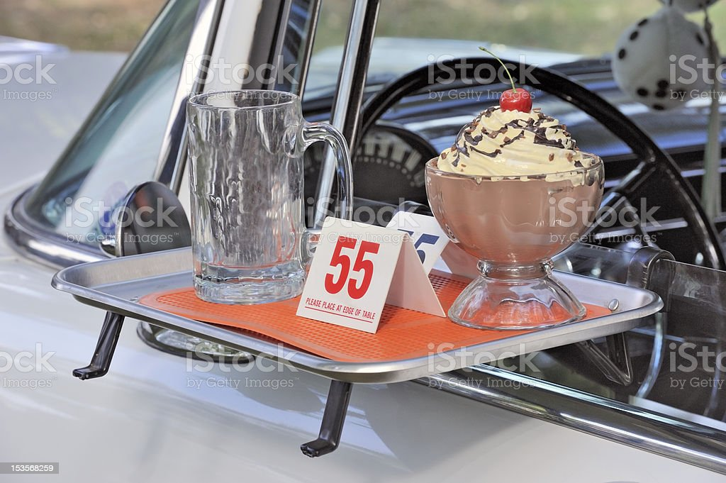 Classic american fifties car and fastfood theme royalty-free stock photo