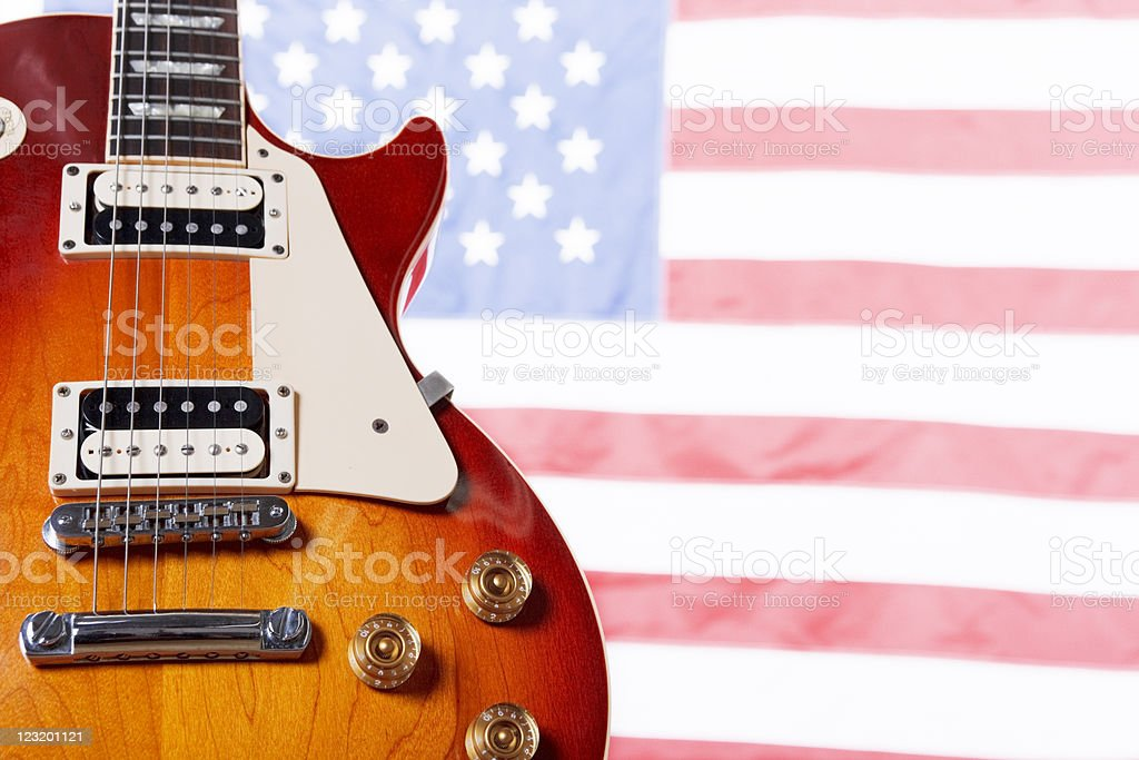 Classic American guitar against US flag stock photo
