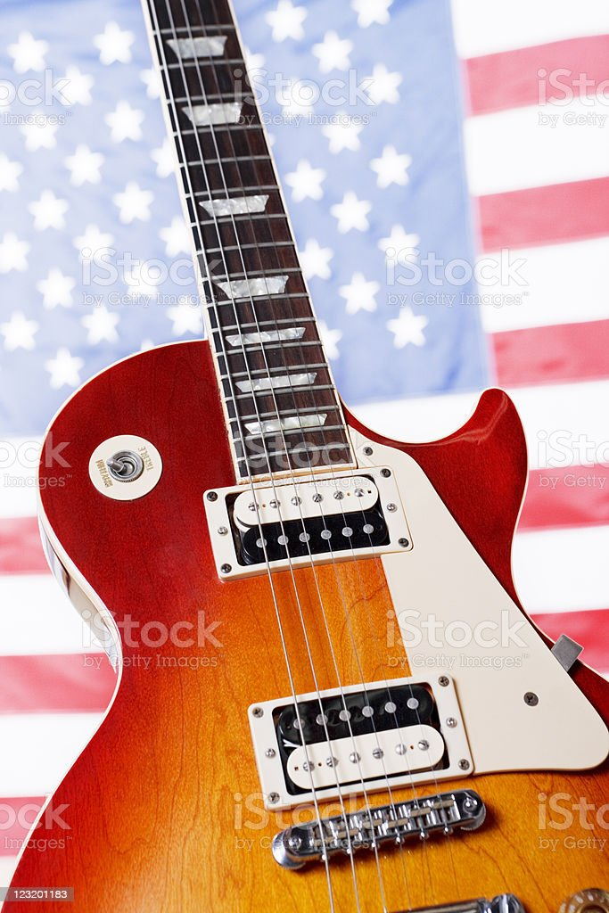Classic American guitar against US flag royalty-free stock photo