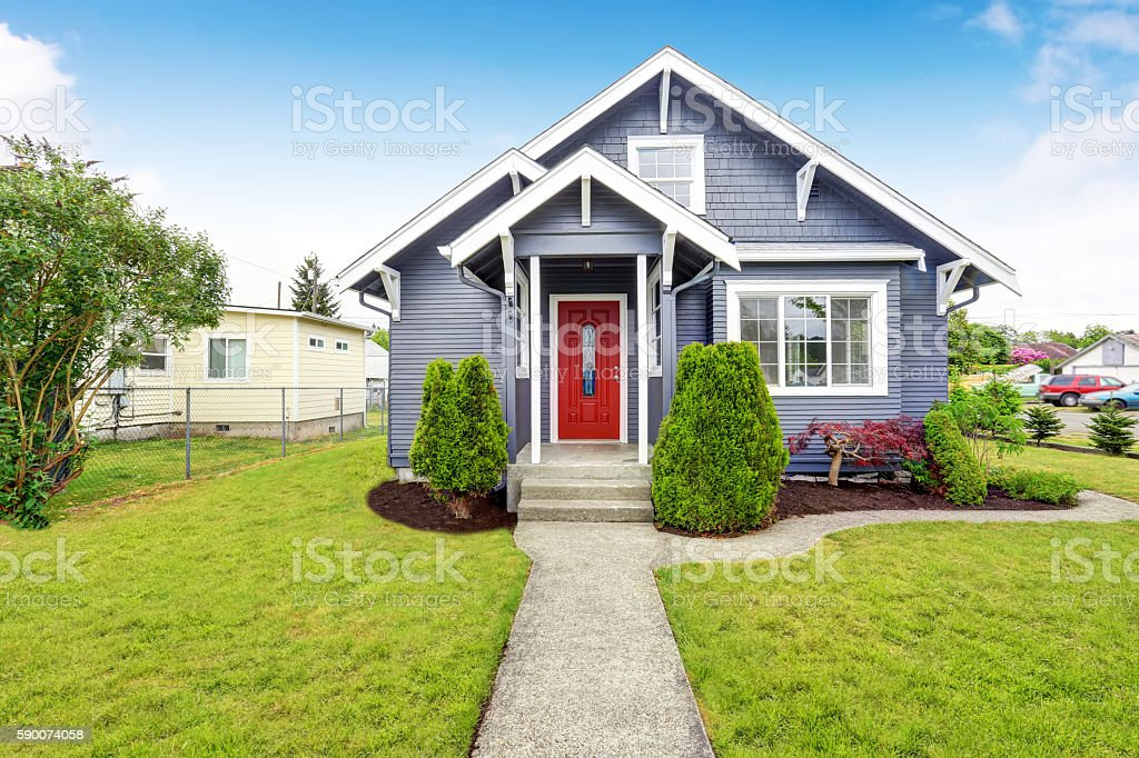 Classic American House With Siding Trim And Red Entry Door Royalty Free  Stock Photo