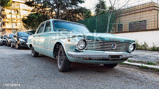 Ostia Lido Rome, Italy - February 4, 2019 : Parked in the street a classic vintage grey car model Valiant produced by American automotive industry Plymouth from 1960 to 1976