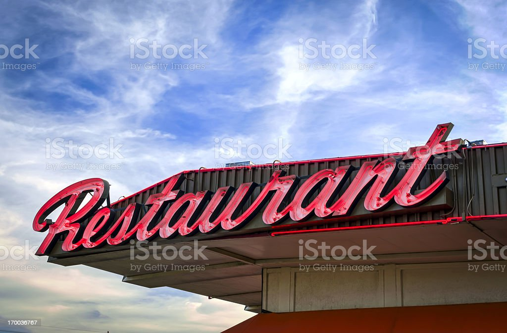Classic Americana Route 66 Neon Resturant Sign at Twilight stock photo