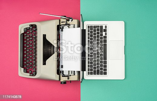 Modern Laptop Computer with Antique Typewriter