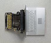 istock Classic analog typewriter vs Modern digital hi-tech laptop computer 135787175