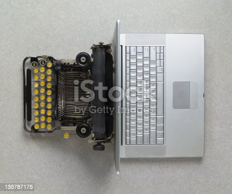 Early 20th Century typewriter vs early 21st Century laptop; back to back