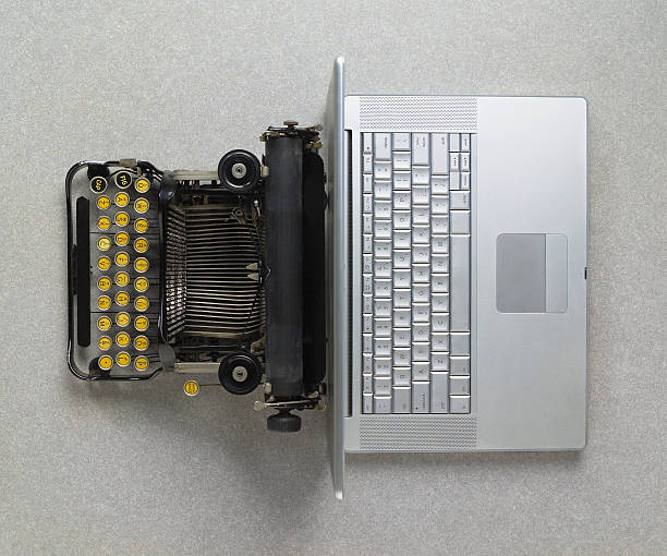 classic analog typewriter vs modern digital hi-tech laptop computer - historic vs new stock photos and pictures