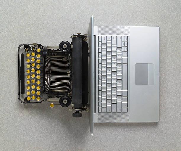 Classic analog typewriter vs Modern digital hi-tech laptop computer stock photo