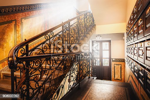 classic and elegant stairs in hallway with sunlights througn window. building interior of european style in resident house