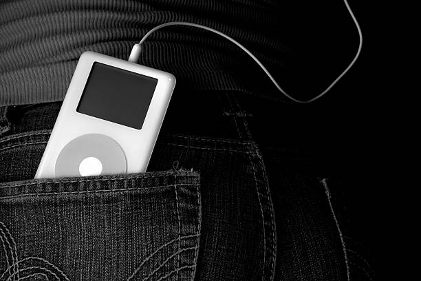 Classic Apple iPod Classic 2nd generation iPod in back jean pocket mp3 player stock pictures, royalty-free photos & images