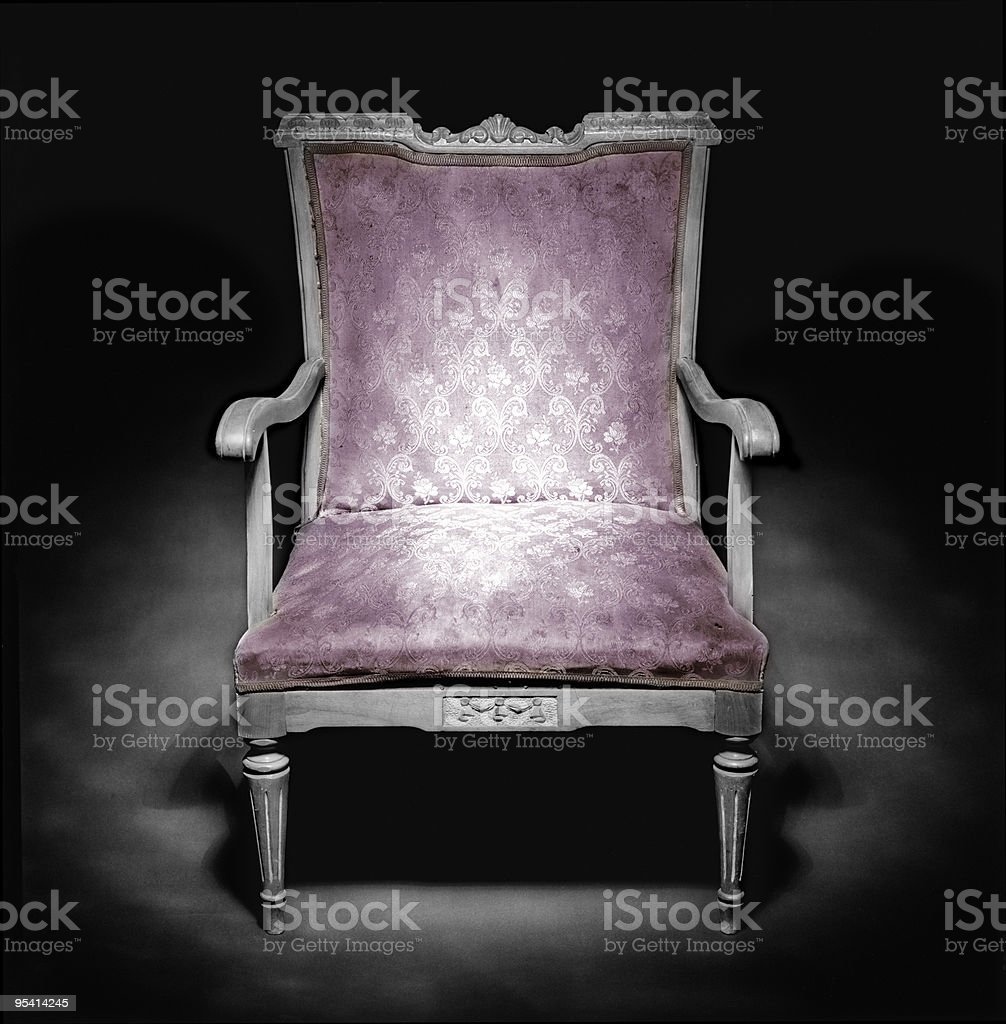 Classic armchair in a dark ambiance royalty-free stock photo