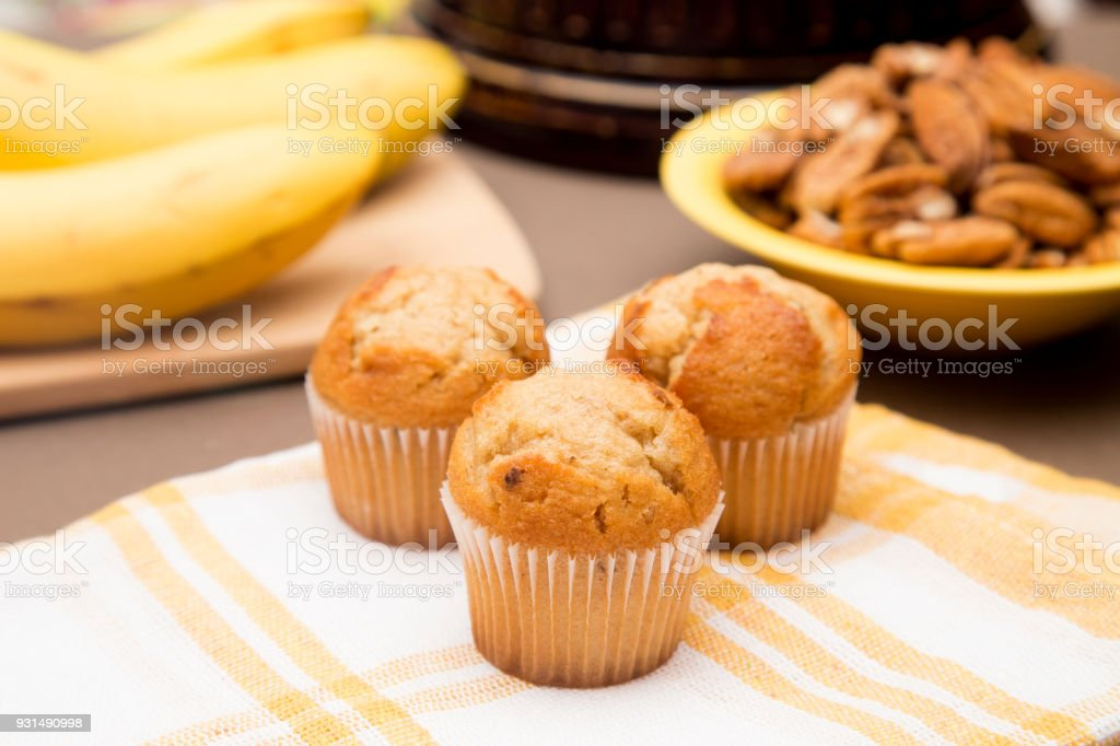 Classic Banana Nut Muffins in a Kitchen with Ingredients stock photo