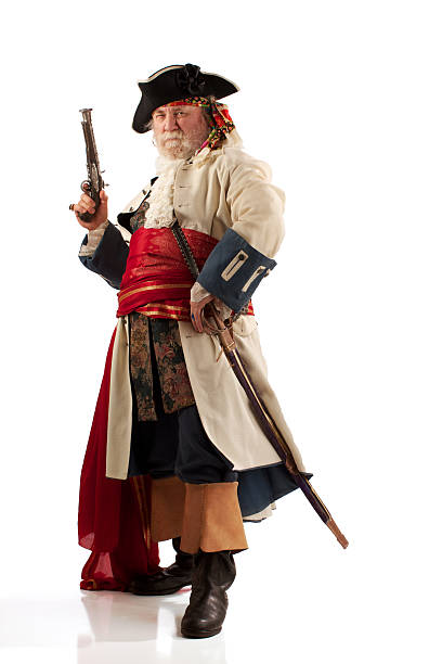 classic bearded pirate captain in defiant pose - swashbuckler stock photos and pictures