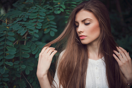 Portrait of a beautiful young woman with a strong healthy hair.