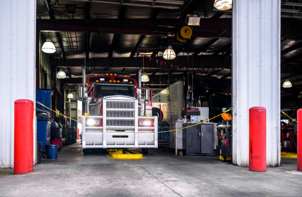 Classic big rig semi truck is being serviced in a specialized workshop equipped for semi truck repairs and maintenance stock photo