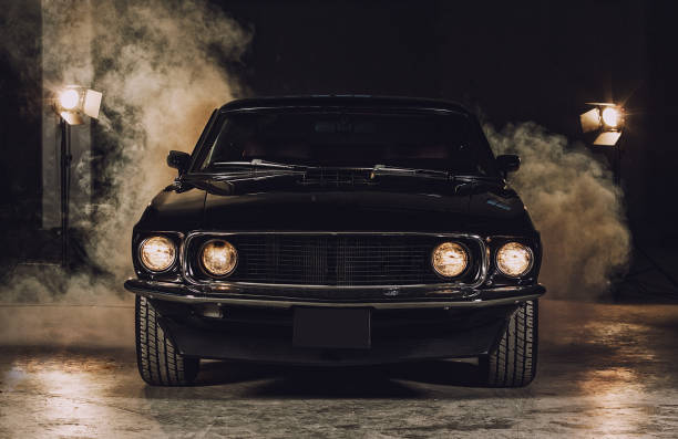 Classic black car in garage Classic black car in garage headlight stock pictures, royalty-free photos & images