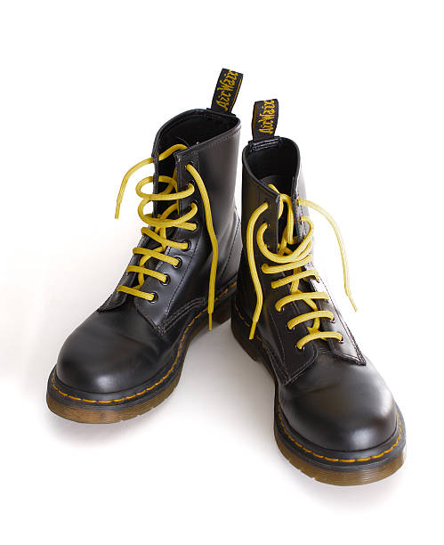 classic black lace-up boots with yellow laces - postal worker stok fotoğraflar ve resimler