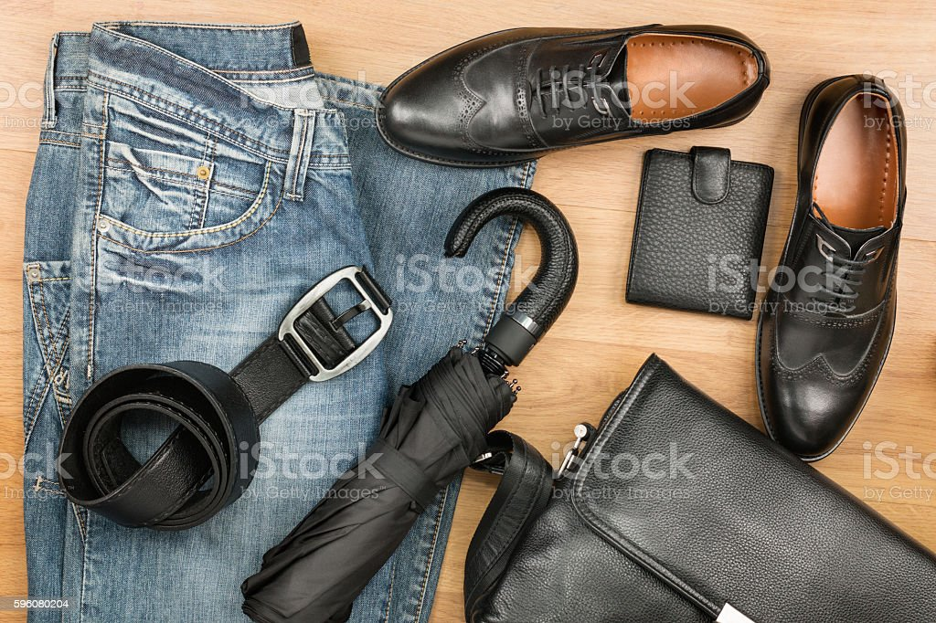 Classic black shoes, briefcase, jeans and umbrella royalty-free stock photo