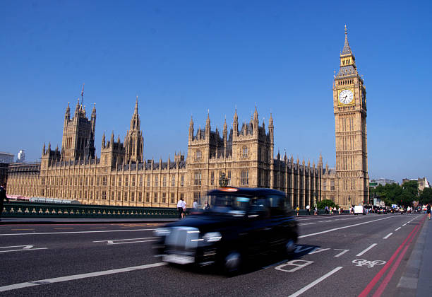 classic black taxi in london stock photo