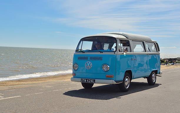 classic blue and white volkswagen camper van - hippie fashion stock photos and pictures