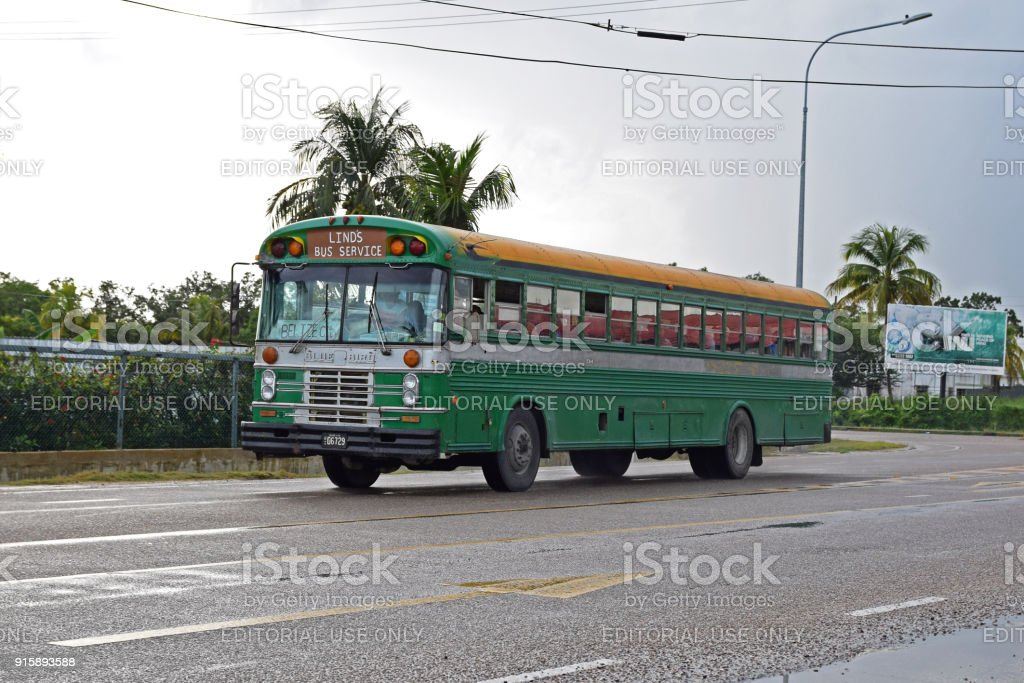Classic Blue Bird bus in motion in Belize City stock photo