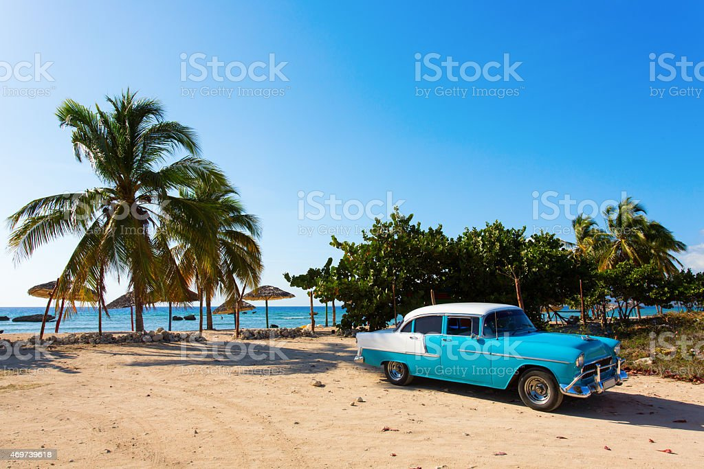 Classic blue car on the beach in Cuba stock photo