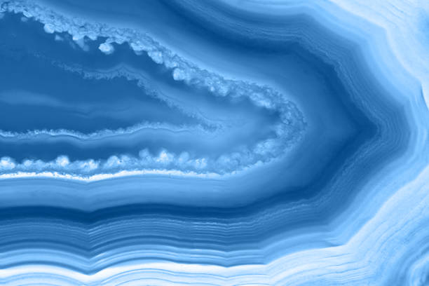 Classic blue color agate slice striped mineral abstract background, color of the year 2020 stock photo