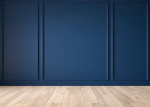 Classic blue color interior blank wall with moldings, wood floor. 3d render illustration mock up.