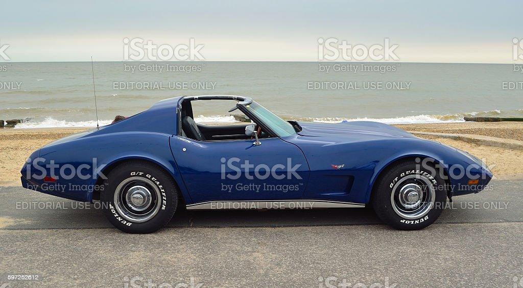 Classic Blue  Corvette Sports Car on seafront promenade. stock photo