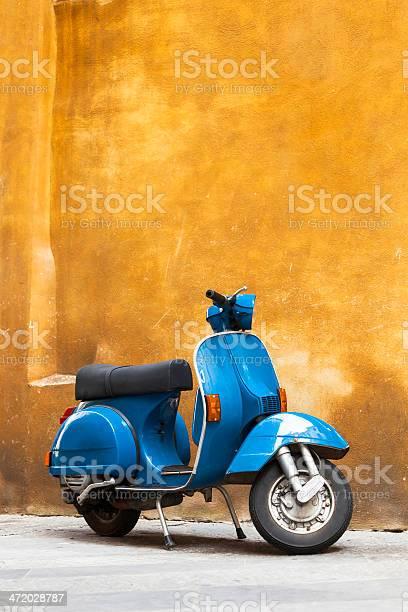 Classic blue scooter against yellow grunge wall tuscany italy picture id472028787?b=1&k=6&m=472028787&s=612x612&h=27pvkfdpzlpwdrl5o lkw g 6rbapzyiiz5yo5q1blw=