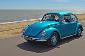 Felixstowe, Suffolk, England - May 01, 2016: Classic Blue  Volkswagen Beetle Car  being driven along Felixstowe seafront promenade.