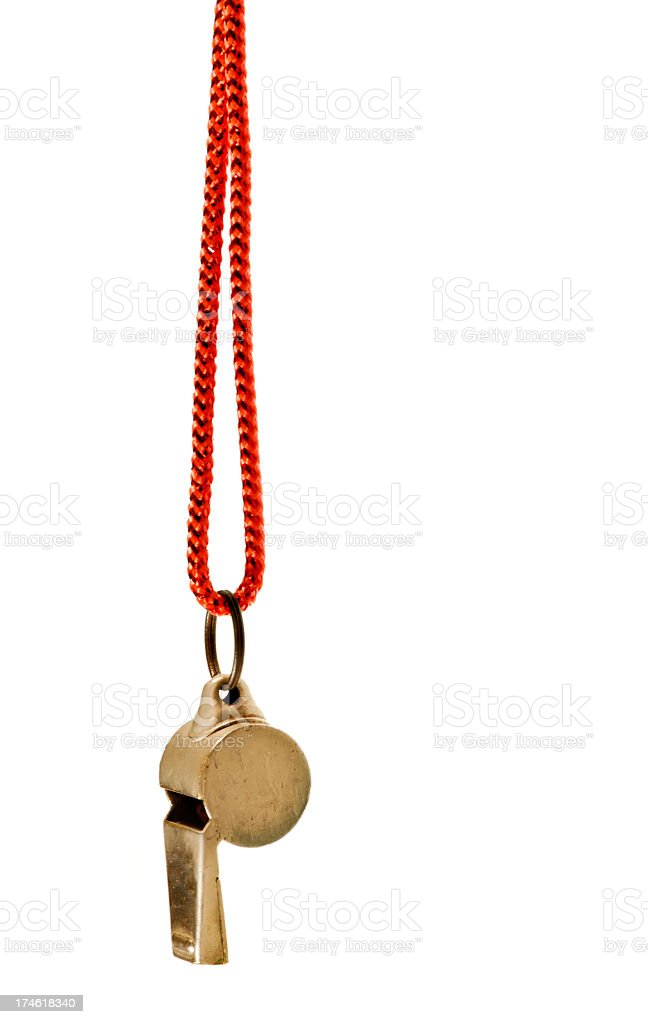 Classic brass whistle with red cord against white background royalty-free stock photo