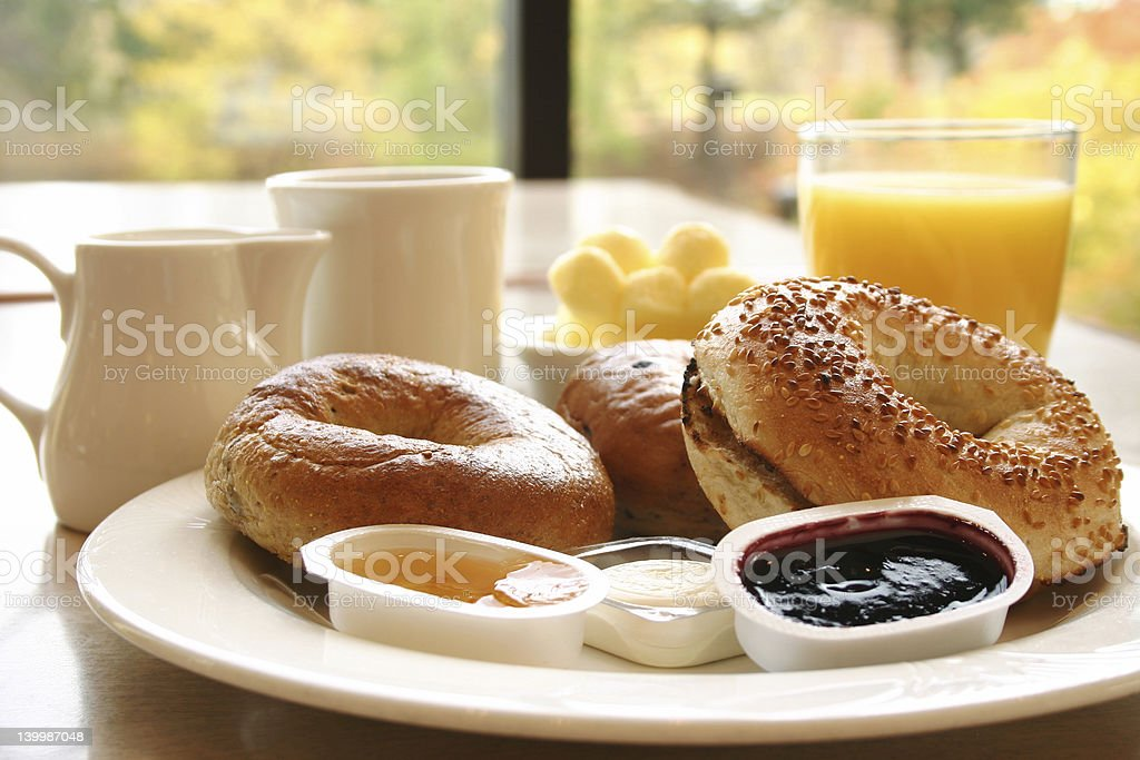 Classic breakfast with bread, jam and fresh orange juice stock photo