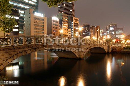 The Okawa River, through the heart of Osaka, at night.