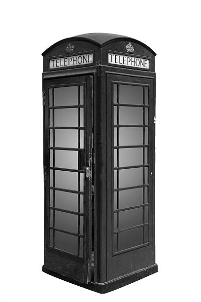 Classic British phone booth in London UK, isolated on white stock photo