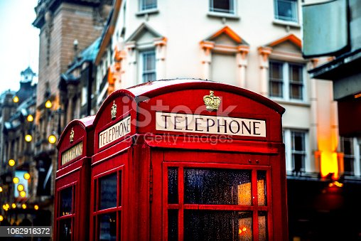 Classic British red colored pay telephone booths  in London, England, UK. Horizontal composition.