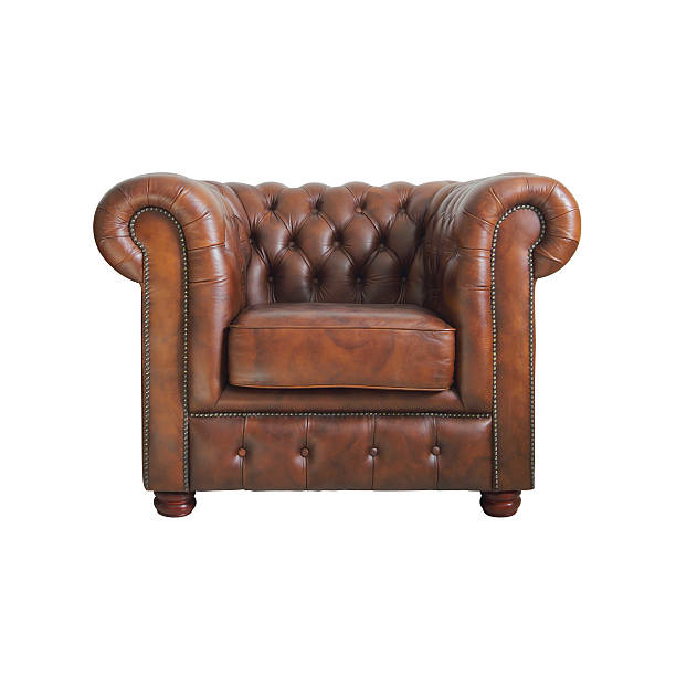Classic Brown leather armchair. Classic Brown leather armchair isolated on white background with clipping path. armchair stock pictures, royalty-free photos & images