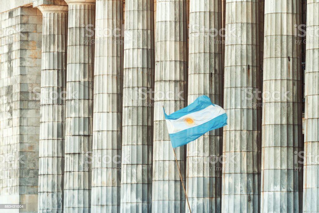 Classic building with columns and Argentine flag flaming stock photo