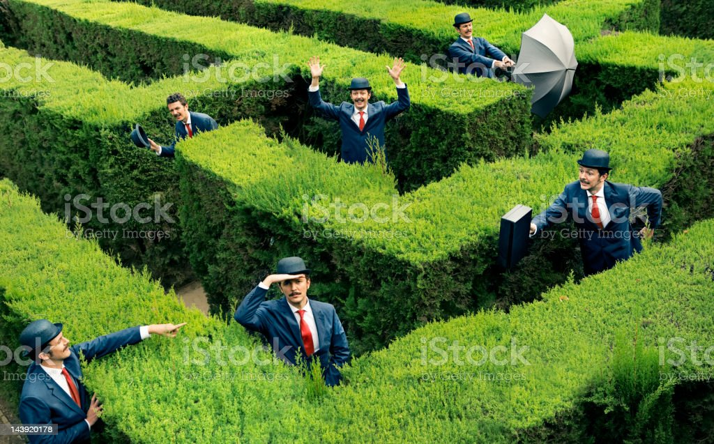 Classic business man looking for the way in a maze stock photo