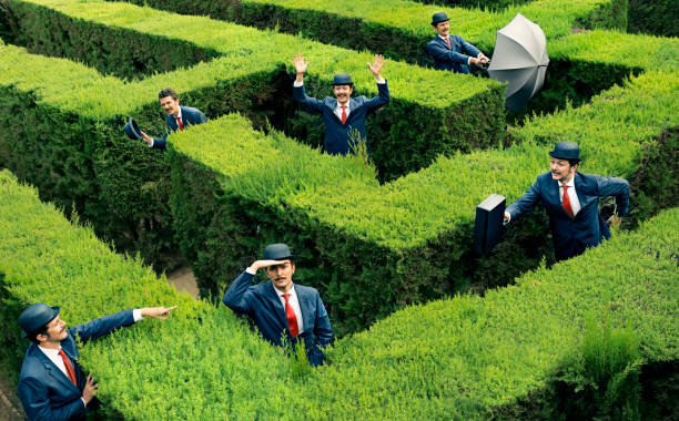 classic business man looking for the way in a maze - maze stock photos and pictures