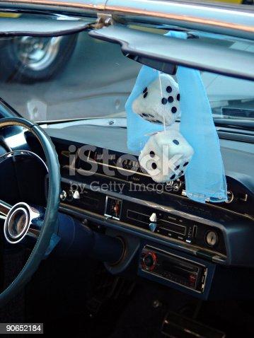 Classic car sporting fuzzy dice