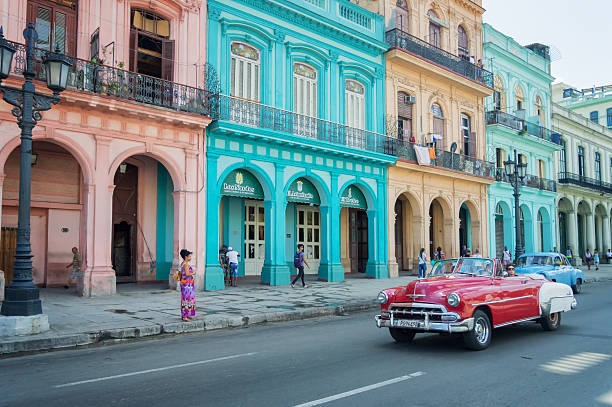 classic car and colorful colonial buildings in old havana, cuba - cuba stock photos and pictures